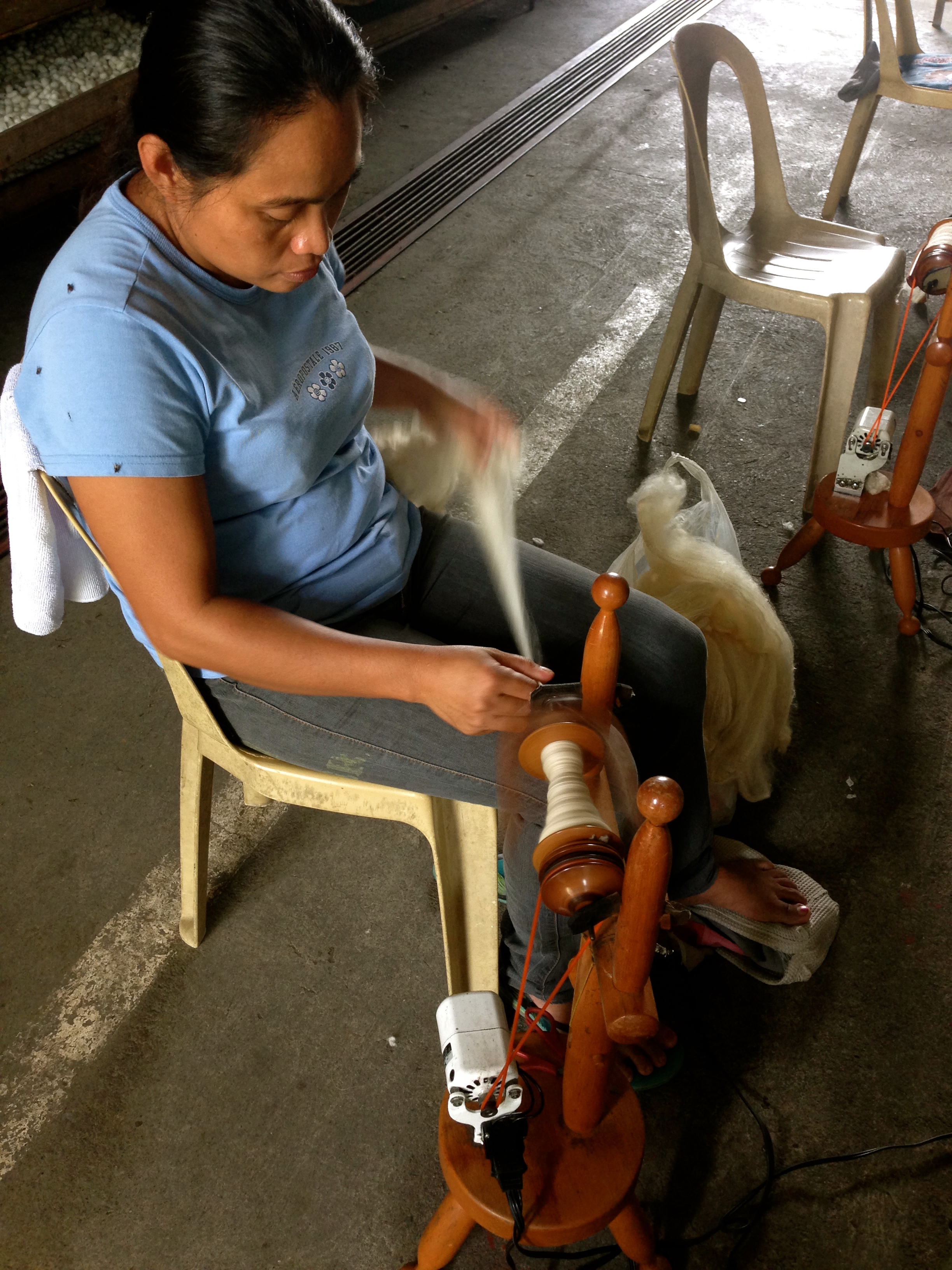 A silk weaver in action